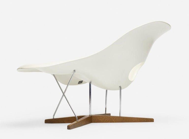 La Chaise by Charles and Ray Eames, 1970s. Lacquered fiberglass, oak, chrome-plated steel, in very good condition.