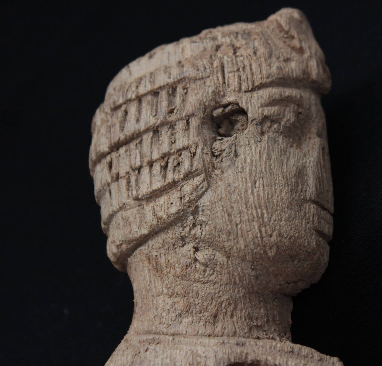 Egyptian cedar wood fragment, with flat side profile, showing a standing Pharaoh in wig, with asp to the front,  attachment peg holes for mounting, his hand with a hole for attaching the flail.       Late Period, 712 - 332 BC