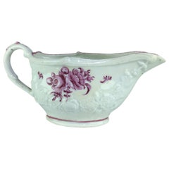 Bristol Sauceboat, Moulded Swags and Painted Puce Flowers, circa 1775