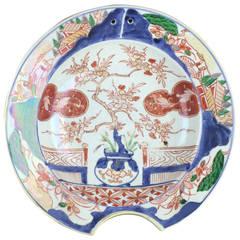 Japanese Imari barbers bowl, garden scene, c. 1680