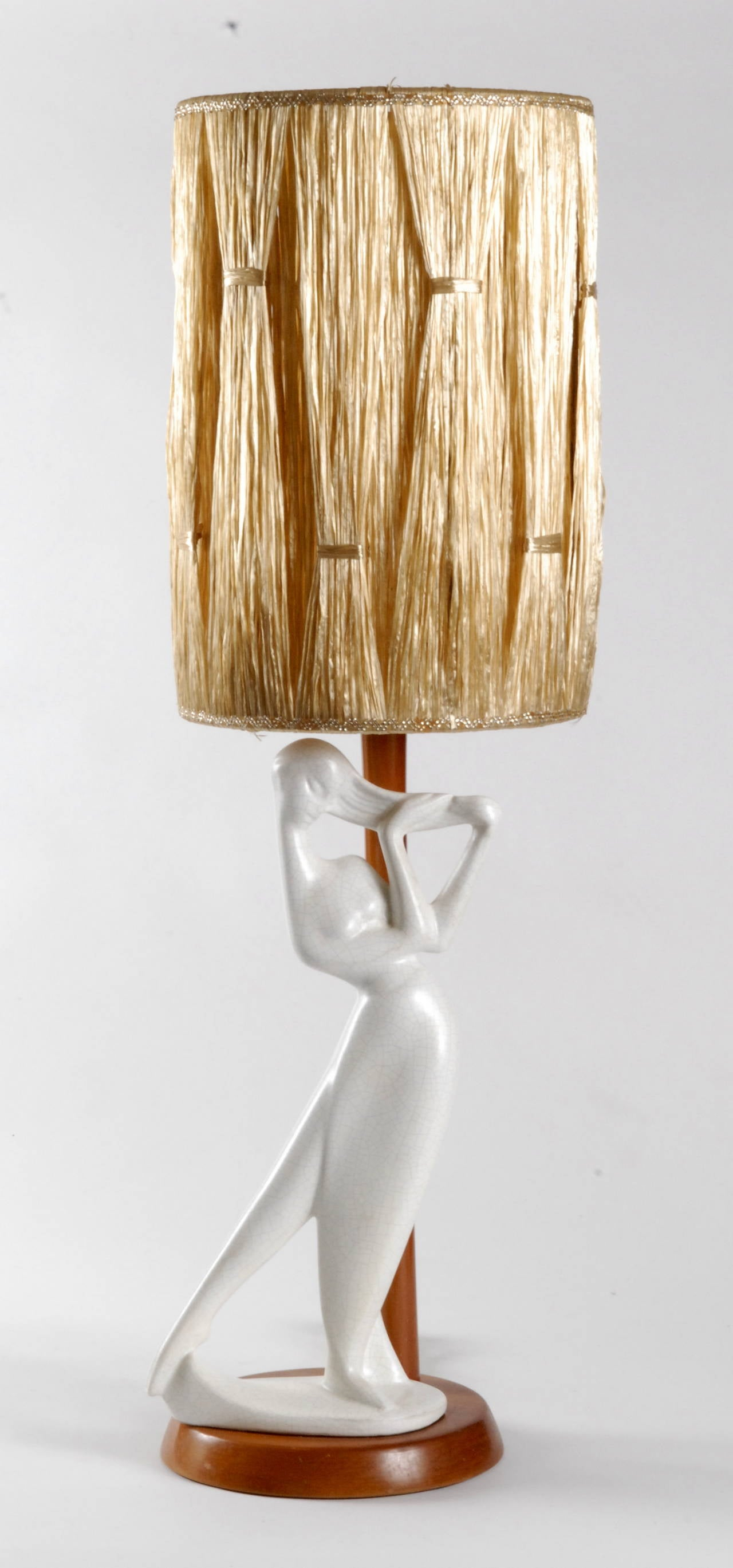 Barsony ceramics is an Australian company founded in the 1950s by Husband and Wife team George and Jean Barsony in a factory in Guildford near Sydney. This very large white lady lamp is very rare, especially with its original raffia shade. The