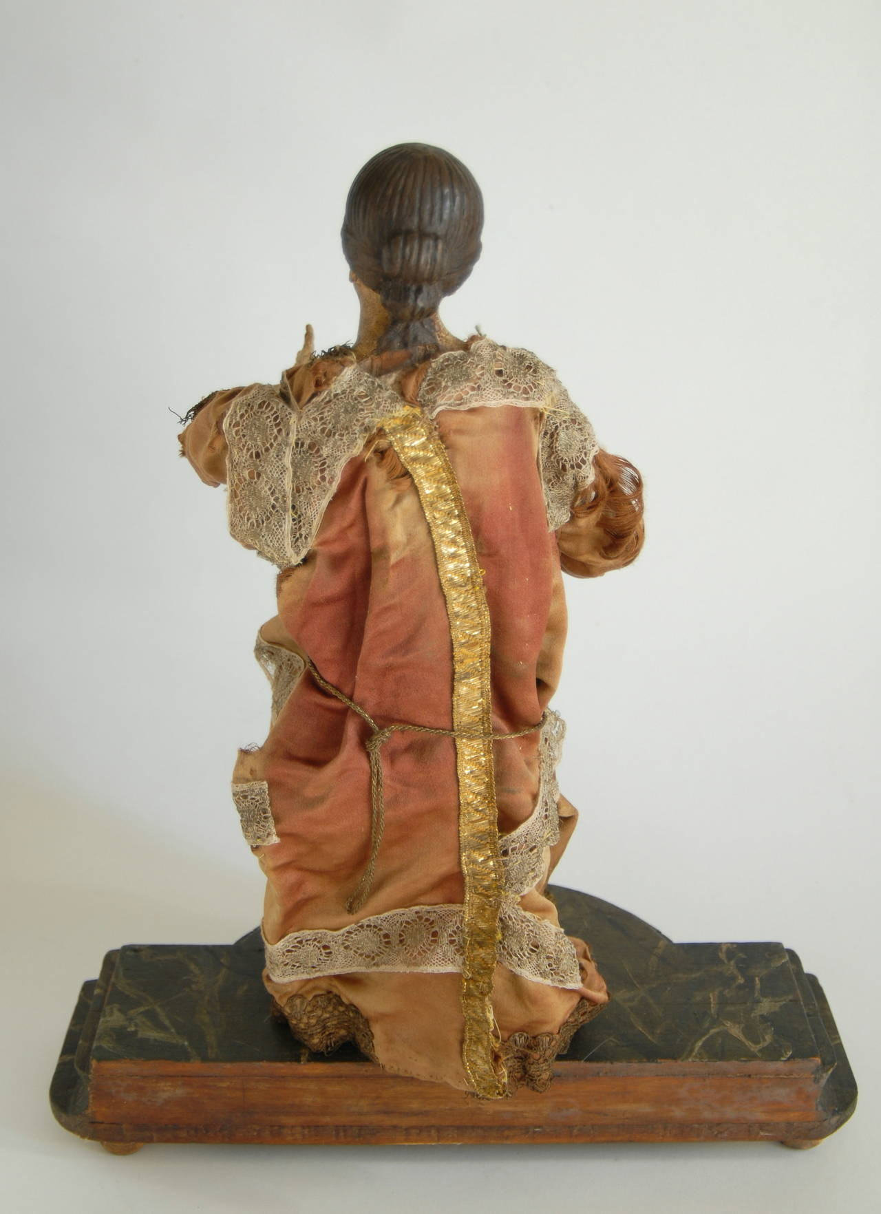 An Italian nativity figure from, circa 1840 with its original fabric costume. Carved from wood with articulated arms, gesso finished head, feet and hands and forearms, painted in naturalist colors, possibly re-painted at later times to maintain