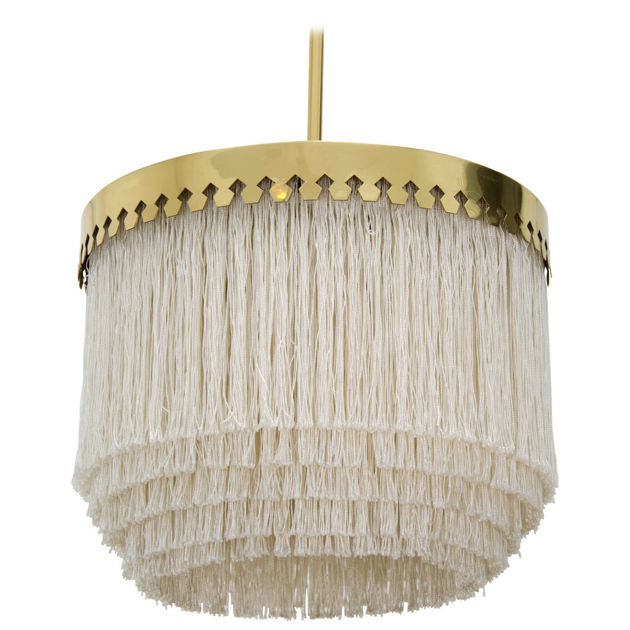 Pendant light by Hans-Agne Jakobsson, Sweden, 1960s.  Unusual and delicate pendant light with cut brass canopy and ivory-colored silk fringes. Good condition with signs of wear in line with age to both the brass and the silk; new wiring and
