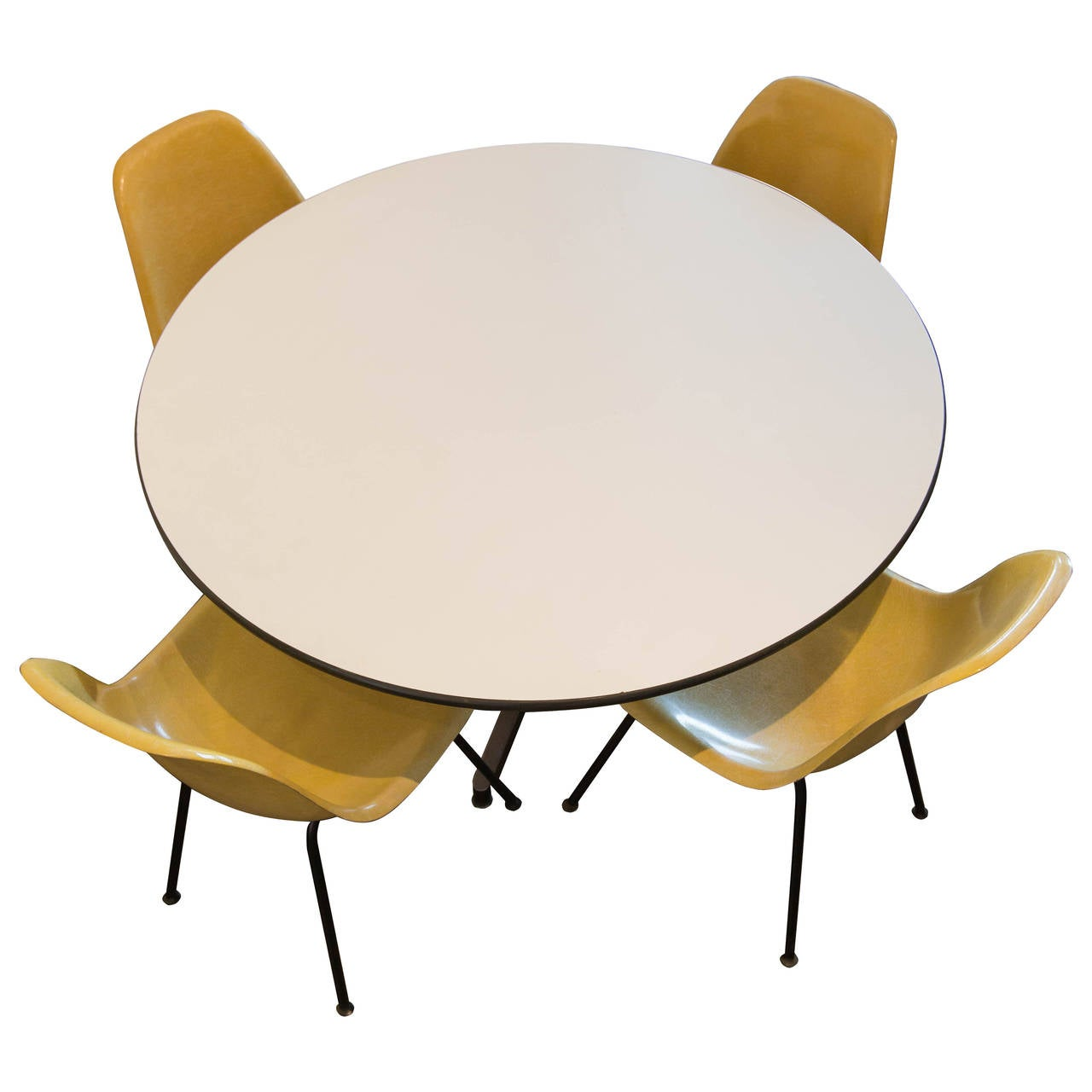Charles eames dining table and four shell chairs by