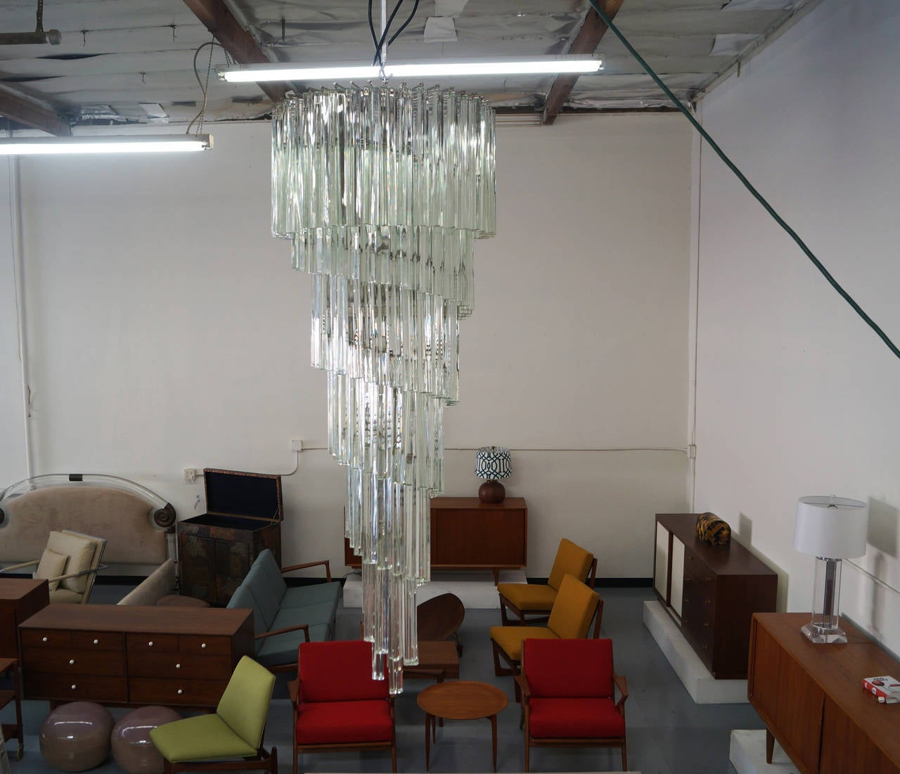 Monumental vintage spiral murano glass chandelier designed by Venini and manufactured in Italy, circa 1960s. This chandelier is made up of elegant solid glass prisms that are aesthetically arranged in the form of a spiral waterfall. Each of the