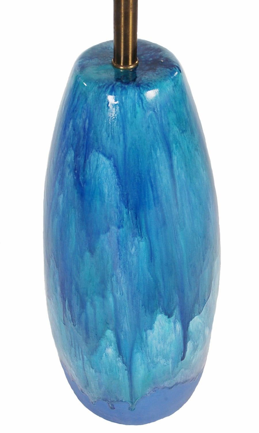 A very large and handsome looking glazed ceramic pottery lamp. Beautiful shades of blue that will cheer up any room.