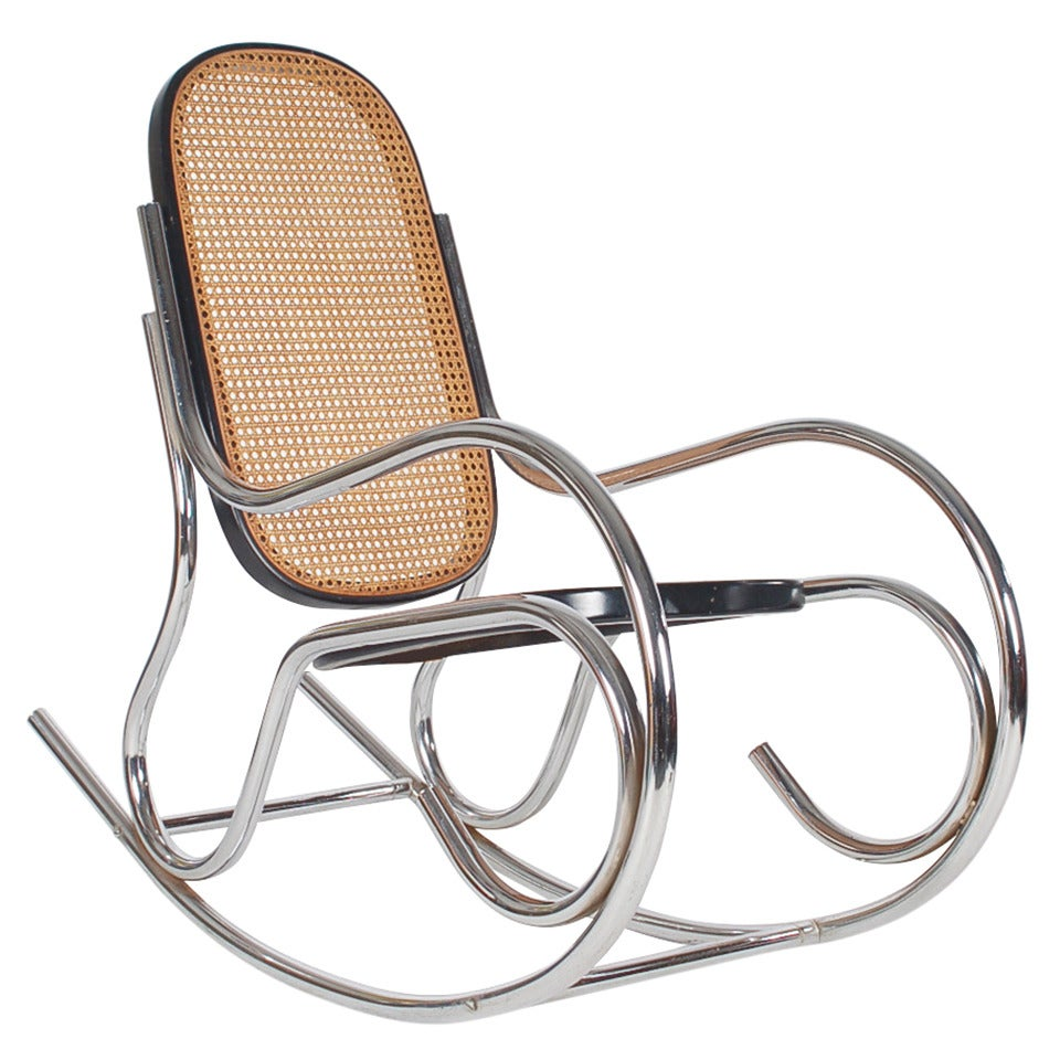 Scrolled chrome and cane rocking chair in the manner of for Chaise bentwood