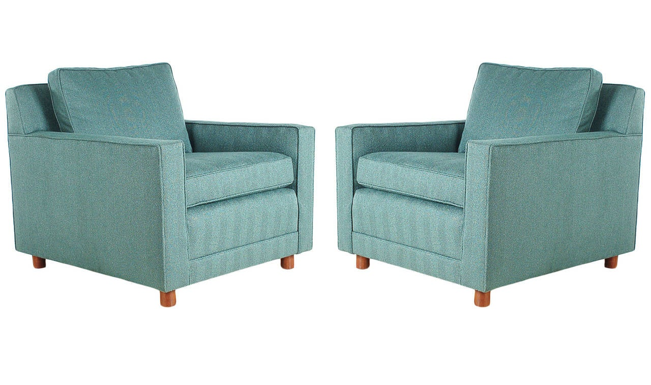 A very high quality matching pair of club chairs, circa 1970s. Completely restored with brand new upholstery.