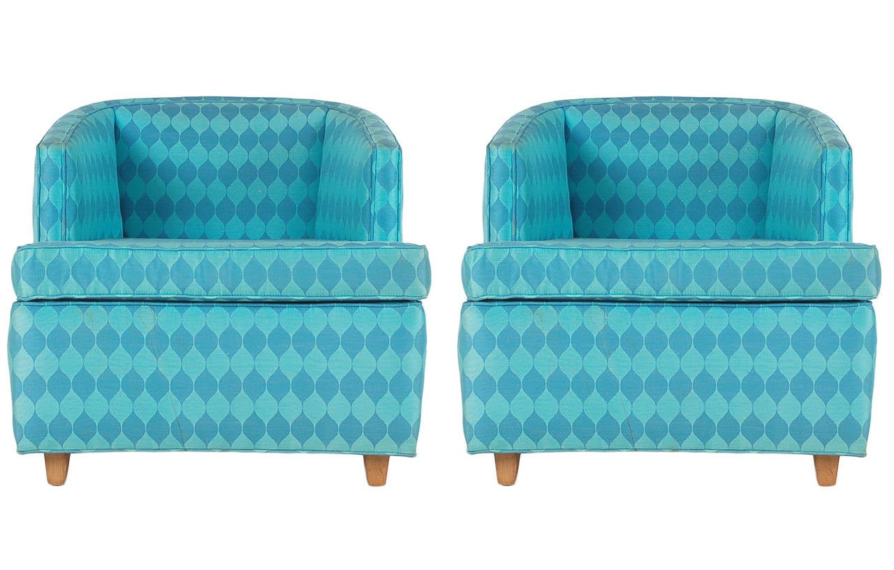 A great pair of club chairs from the late 1960s in the style of Edward Wormley. Upholstery has some light soiling and can be reupholstered at $600 per chair (buyer supplies fabric).
