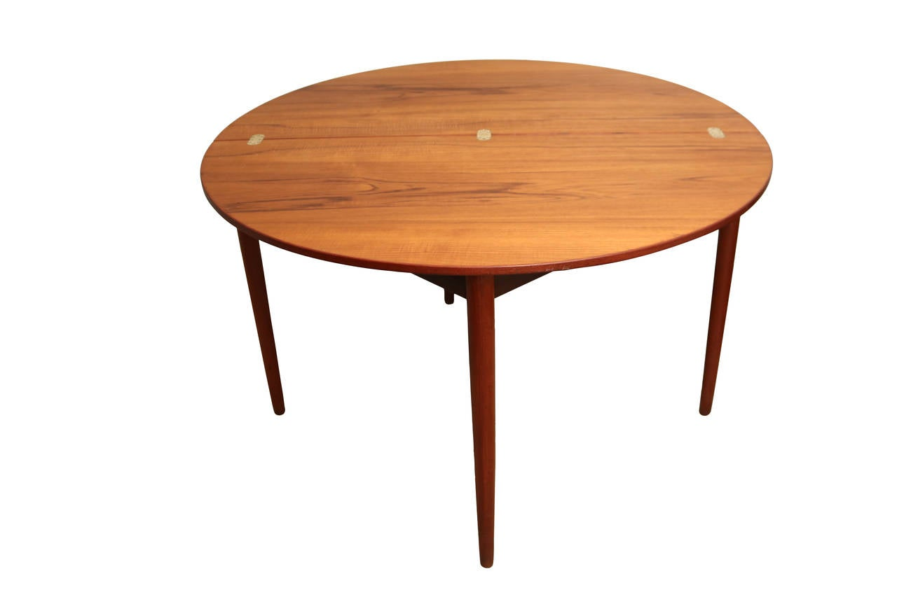 Round teak folding dining table and chairs by poul volther for Dining chairs and tables