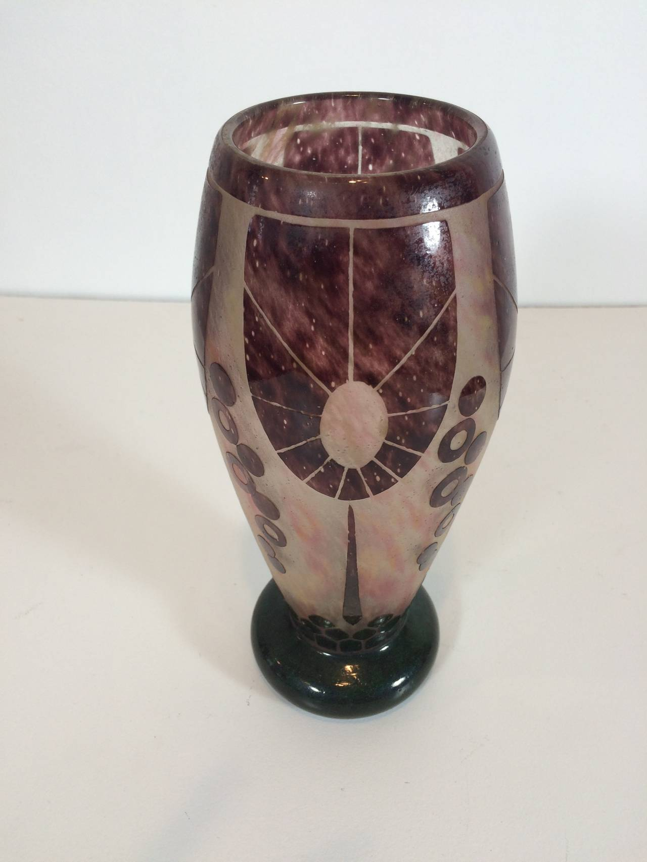 Purple with dark green base, relief and etching vase. Stunning color and form, candy cane marking on bottom indicates 1927 production. Le Verre of France.