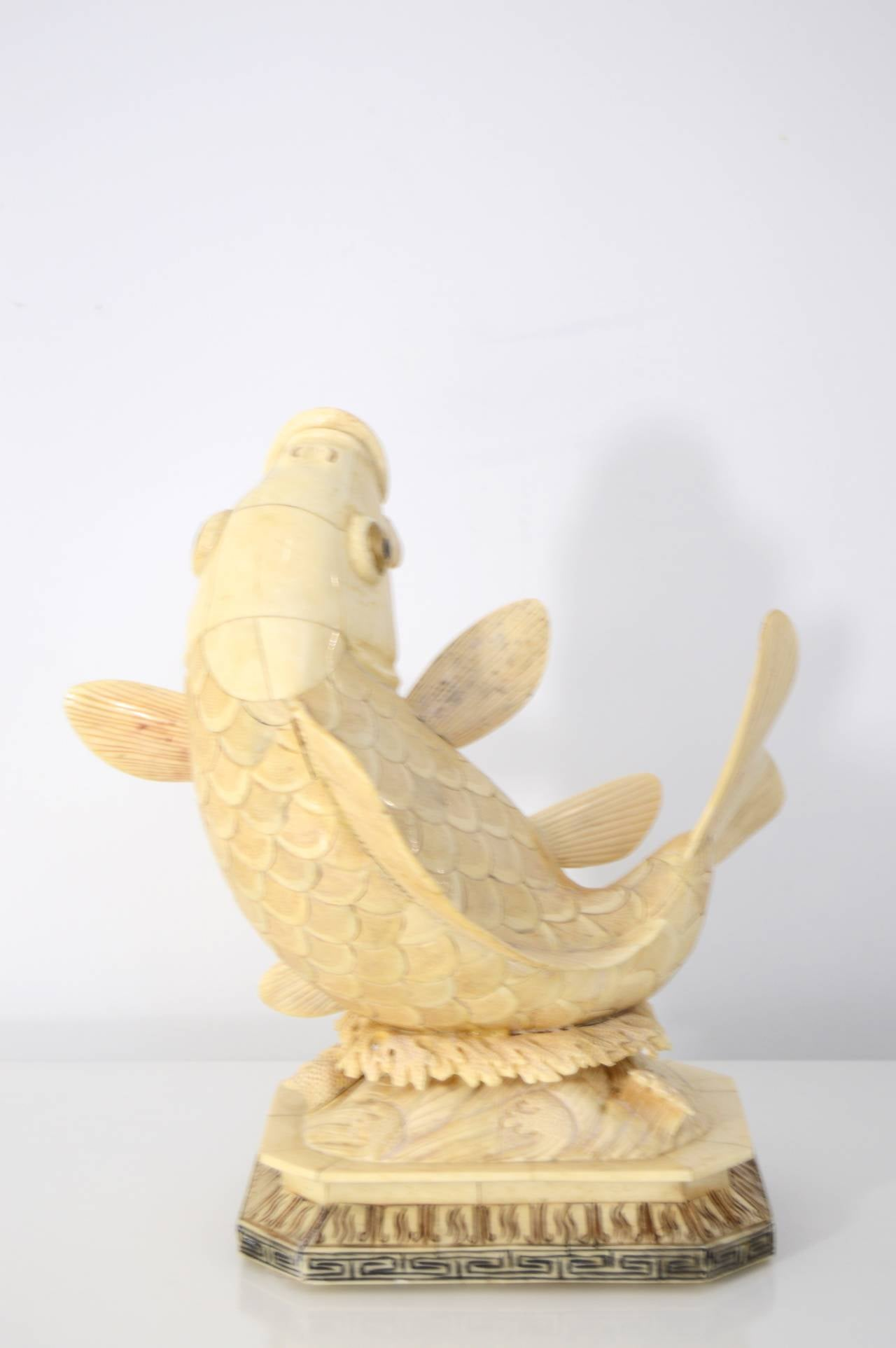 Antique asian carved bone sculpture of a koi s for