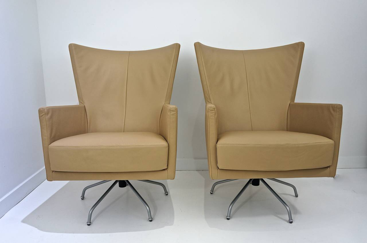 Pair of modern italian swivel lounge chairs upholstered for Contemporary furniture west palm beach