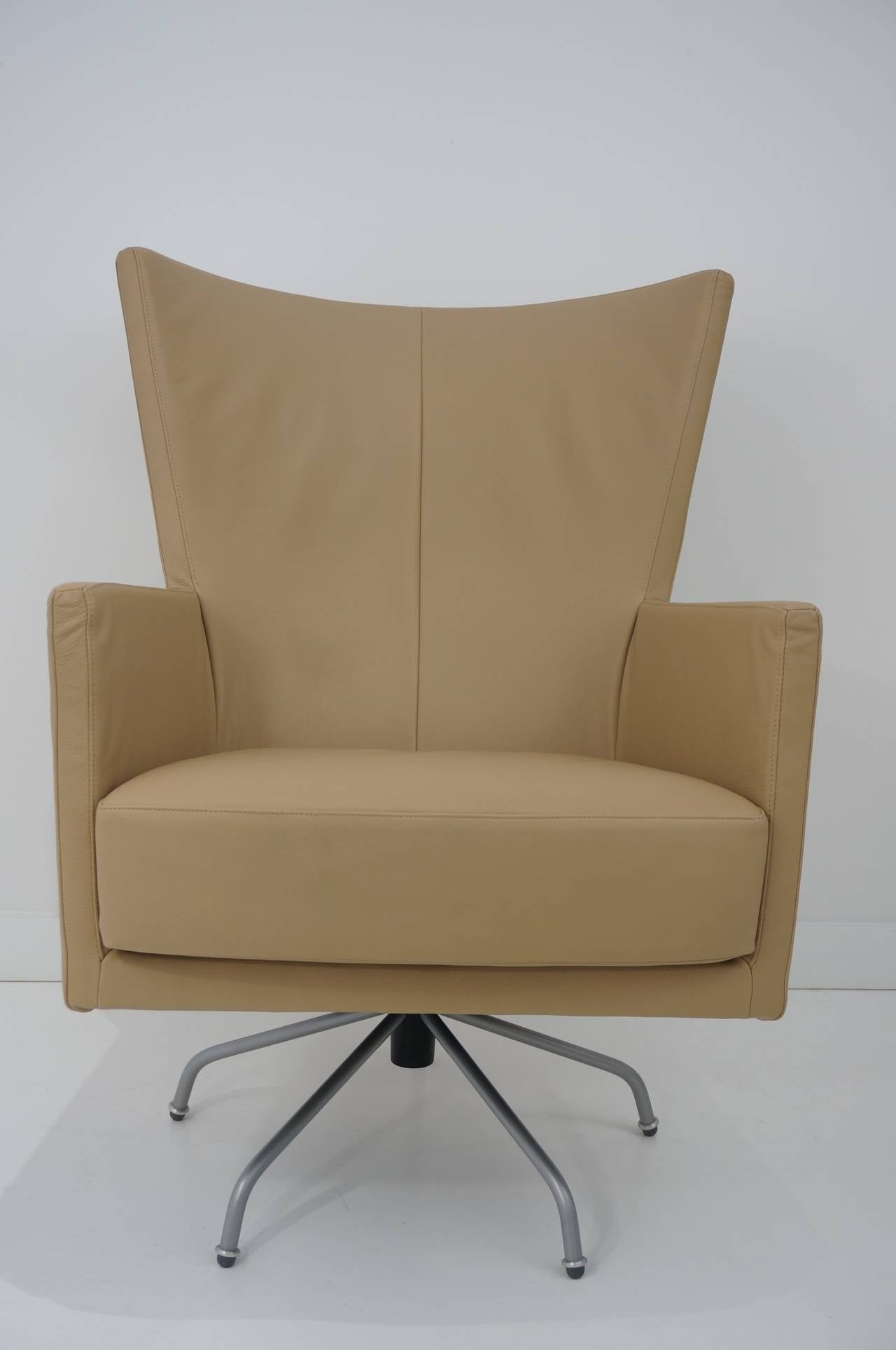 Pair of modern italian swivel lounge chairs upholstered for Modern leather club chairs