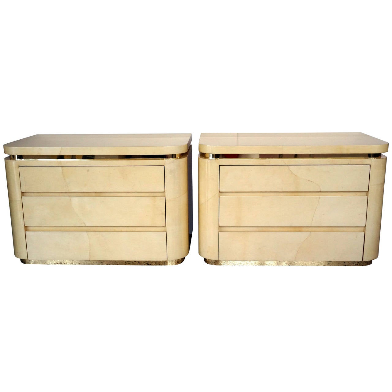 pair of enrique garcel style goatskin three drawer bedside chests