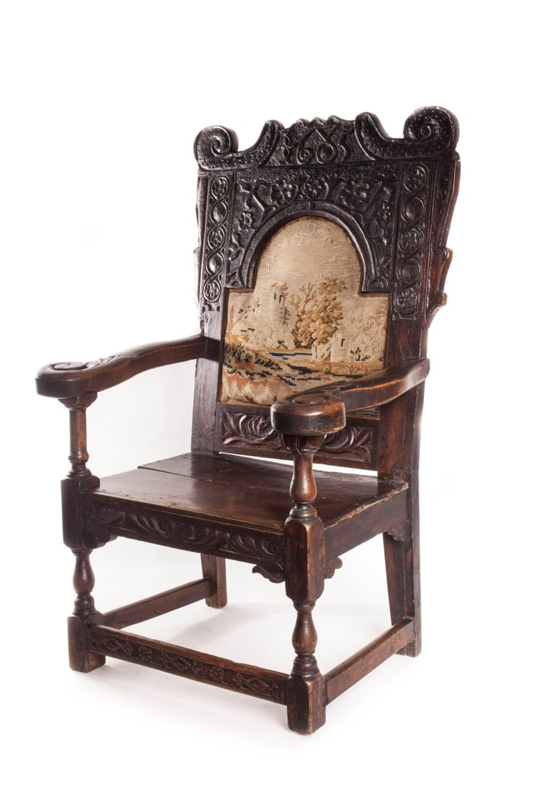Beautiful 17th century English Jacobean armchair. Carved floral motifs and inset tapestry back. Date is carved into the back head rest. 1685.