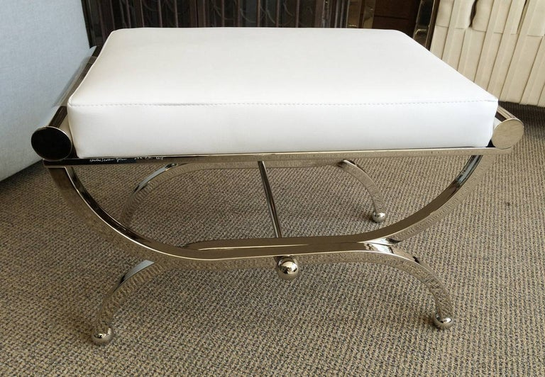 We have three benches ready to ship, two in brass and one in nickel.  Exceptional pair of Empire style benches designed and manufactured by Charles Hollis Jones. The benches were designed in the 1960s and they are just as influential