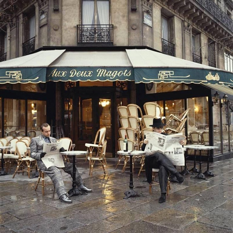 Terry O'Neill Color Photograph - Elton John & Bernie Taupin Cafe in France