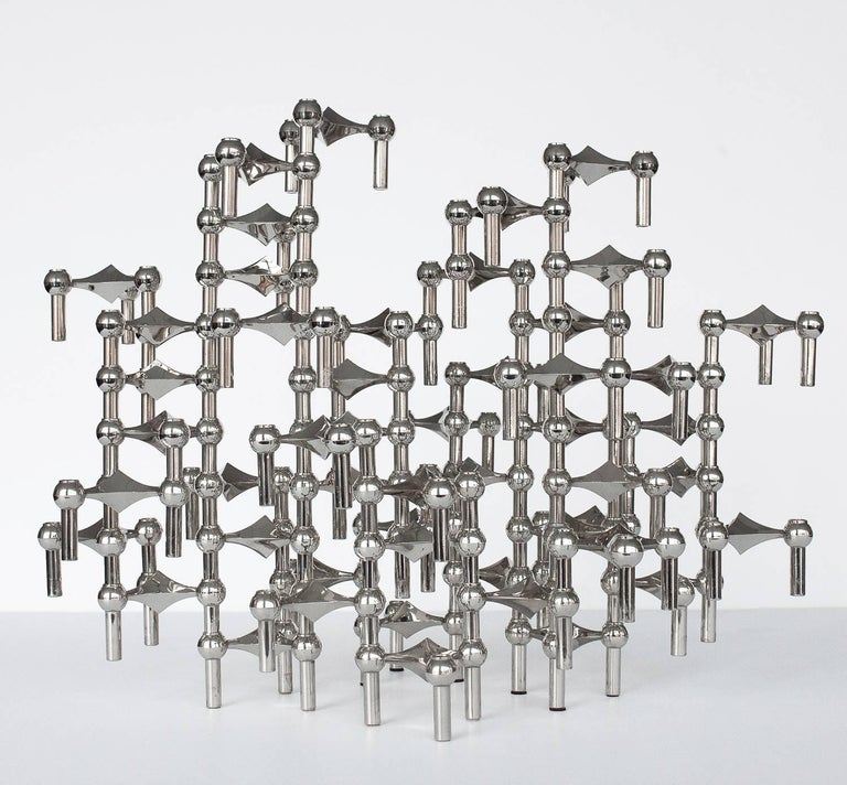 A sculpture made of 56 individual candleholders by Caesar Stoffi and Fritz Nagel for BMF, Germany. This modular design can be configured in an endless number of ways both vertically and horizontally by stacking each interlocking piece. Perfect as a