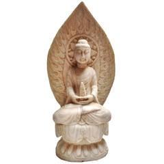 Marble Buddha Holding a Pagoda