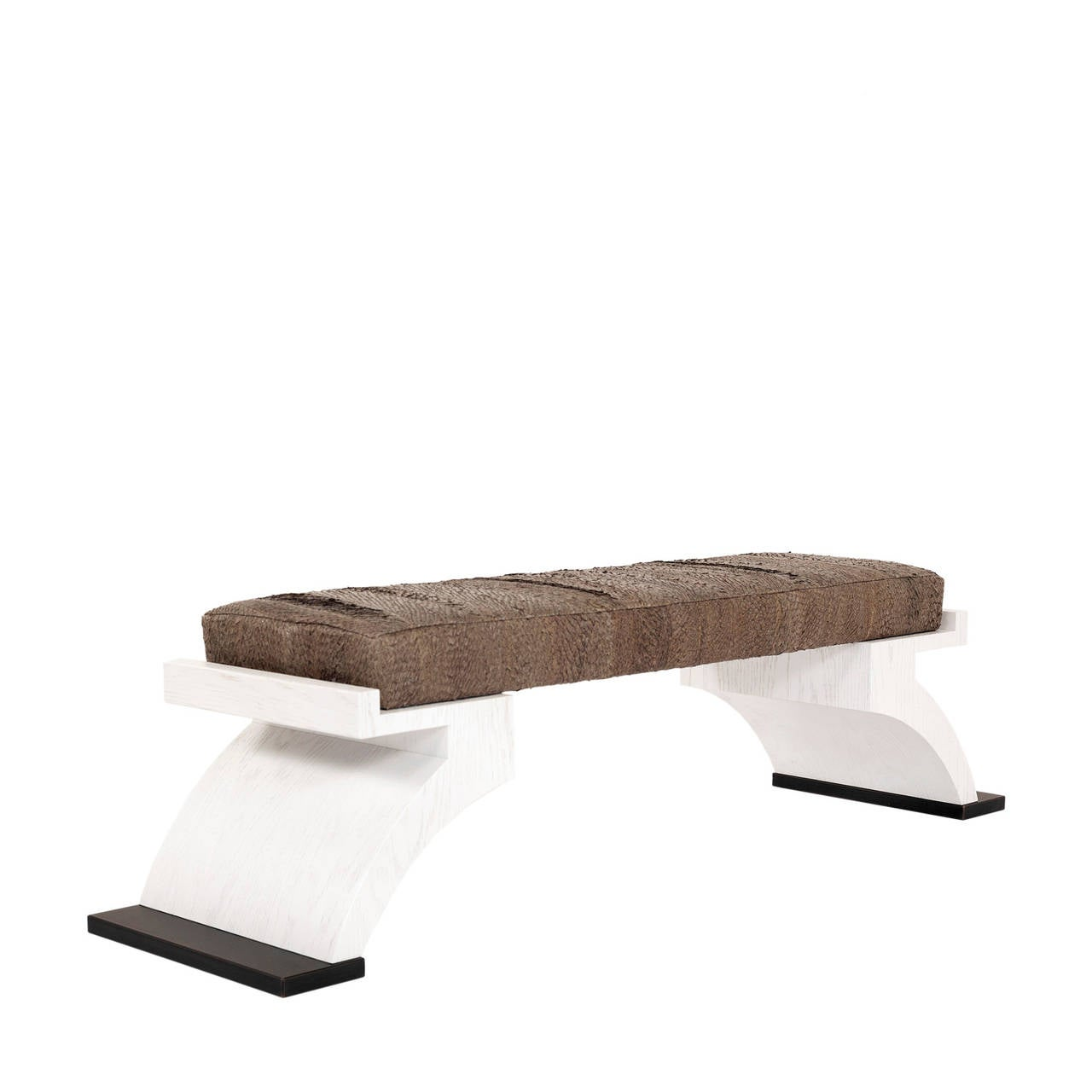 The Teres is a sophisticated white oak bench with elegant lines and beautiful mix of materials, including bronze Patina feet, white oak curved legs and upholstered in a beautiful Brazilian fish skin.   This item is available immediately in the