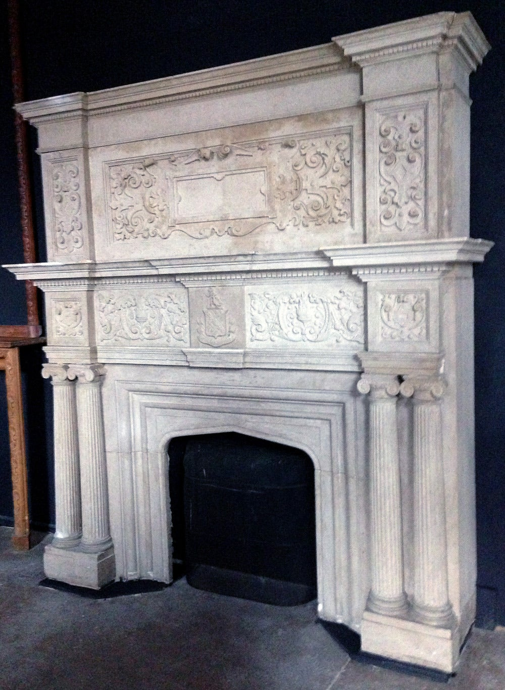 Large indiana limestone tudor revival style fireplace for Tudor style fireplace