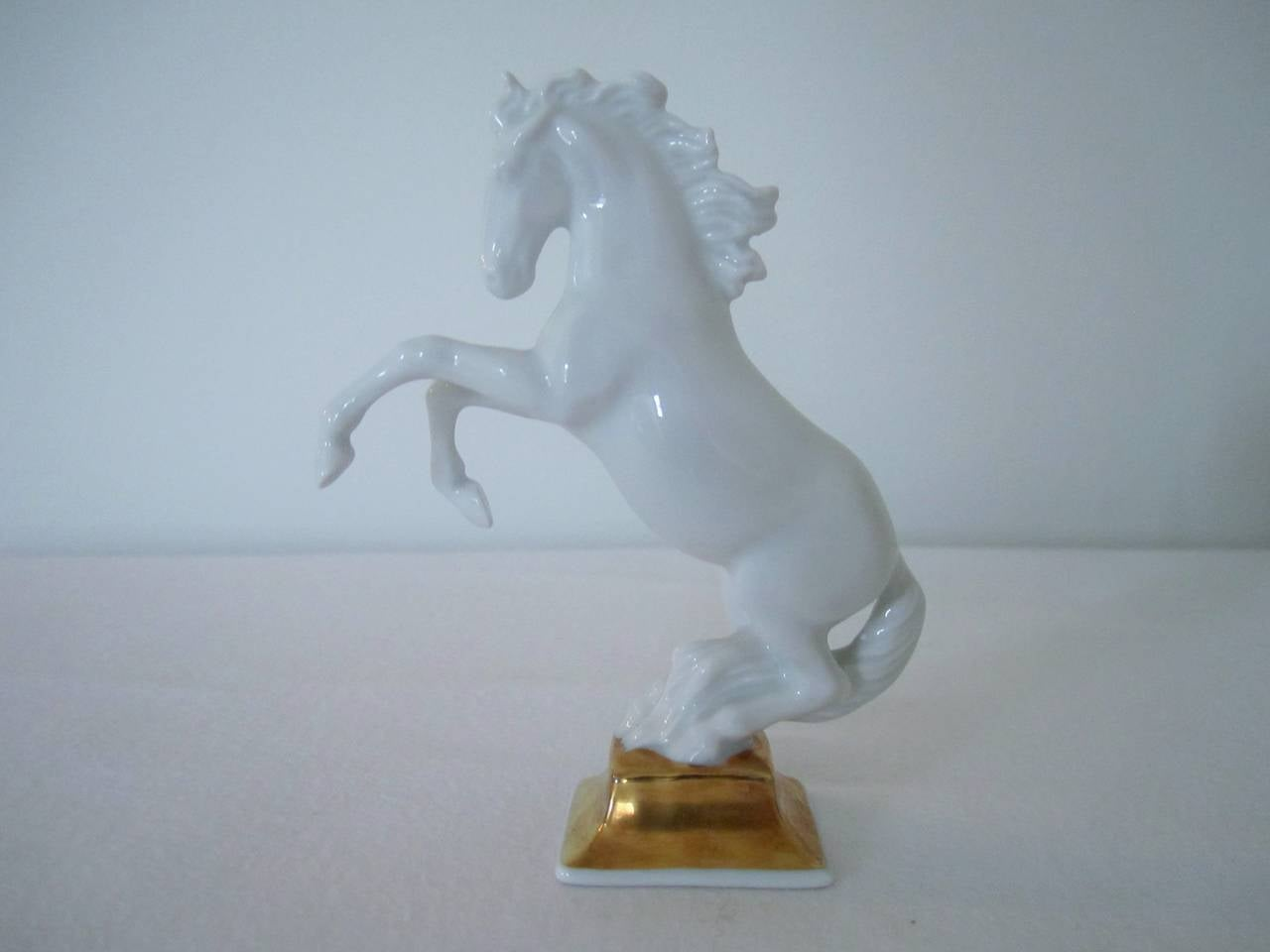 A vintage blanc-de-chine porcelain Horse Sculpture by artist Max Hermann Fritz for Rosenthal, Germany, with 24-Karat gold hand-painted base detail. Sculpted by M H Fritz (name impressed in the base with model number 1027/7 and Rosenthal marking.)
