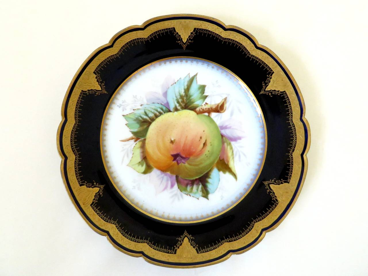 Six 19th century porcelain plates with beautifully decorated centers of different fruit varieties with cobalt blue rim and gold outlines.