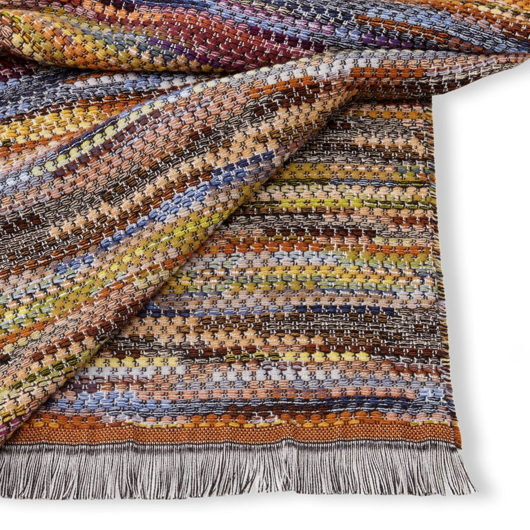 MissoniHome multicolored woven throw in iconic color palette. All Missoni Home products are custom made to order with the highest quality materials. Perfect for adding an elegant touch to any bedroom or living room.  Composition: 50% wool, 50%