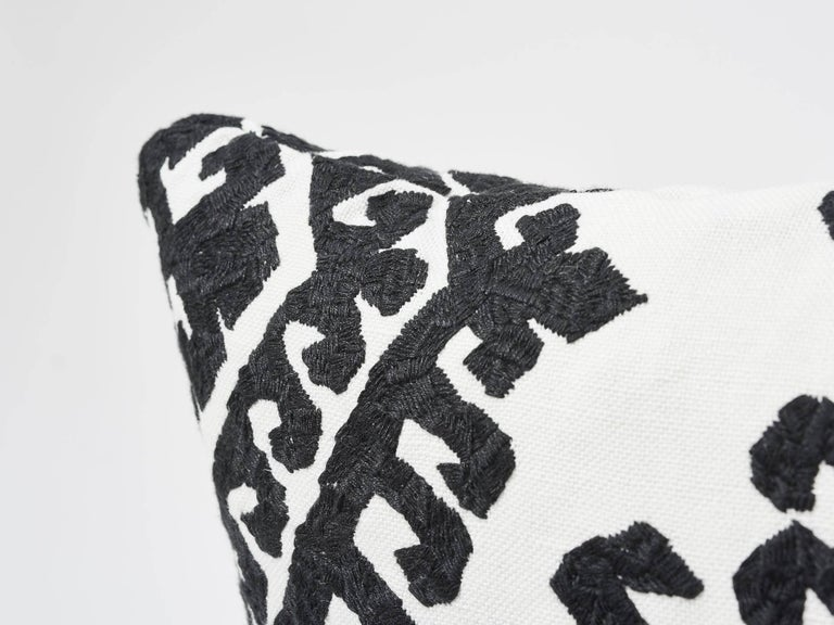 This all-over Schumacher embroidery has a visual strength that does not overpower because it is softened by the art of the hand. In its black and white color way, this Omar Embroidery decorative accent is classic and versatile to complement as an