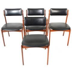 Set of Four Erik Buck Dining Chairs in Teak and Black Vinyl
