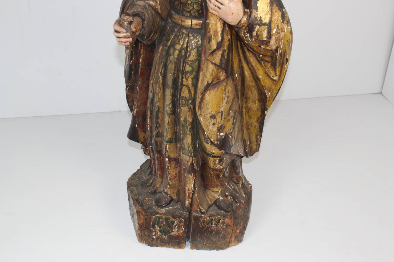 Virgin Mary Santos sculpture in gilt and poly chromed carved wood.