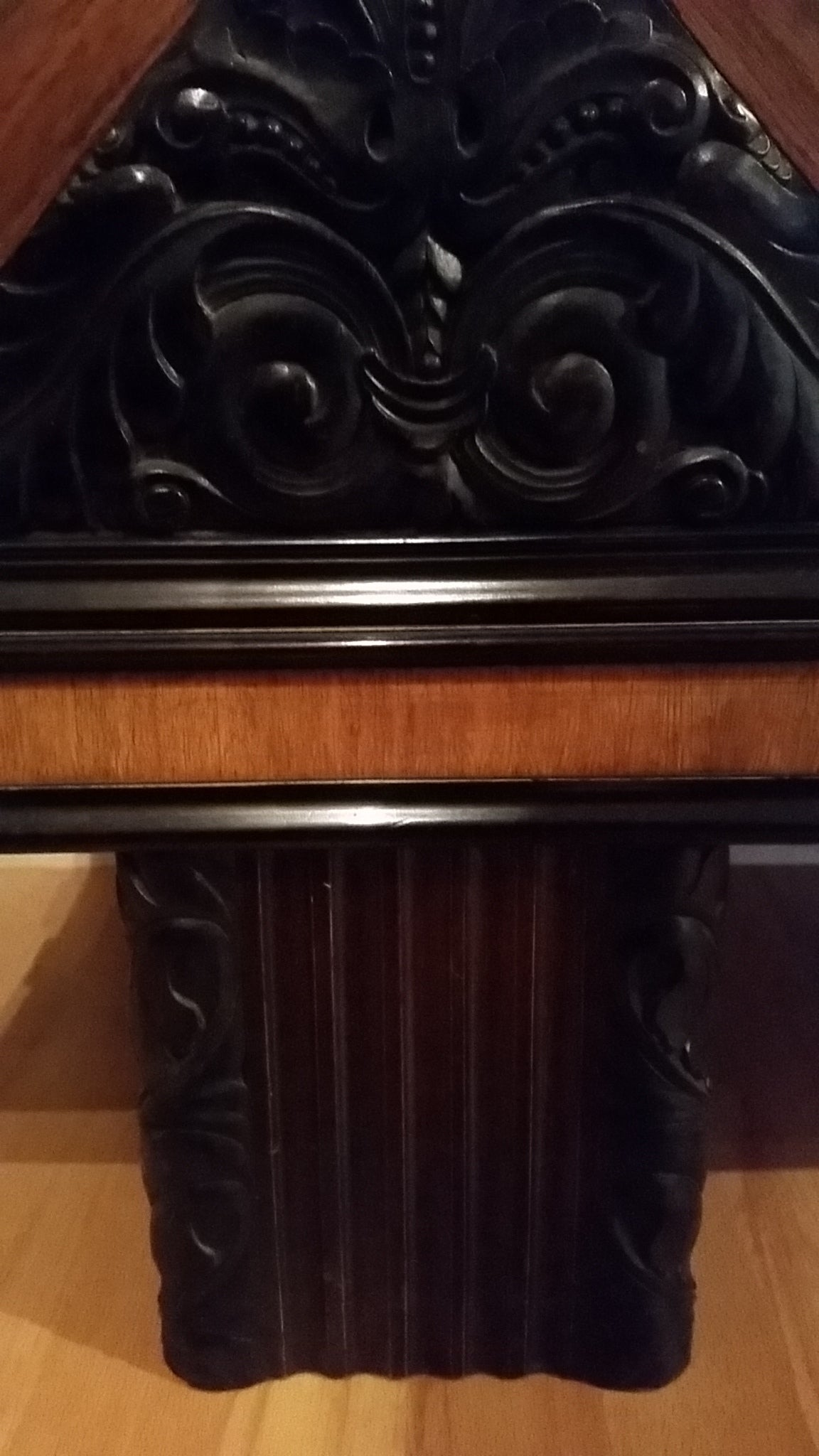 Art Deco cabinet, entertainment center.  A beautiful European style Art Deco cabinet with very nice detailing. Dark wood and hand-carved accents create exquisite contrasts throughout this piece. A perfect bookcase and/or display case for