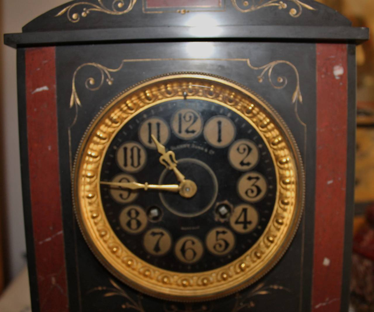 19th century French marble mantle clock.  High quality black marble with red marble accents retailed by Glenny & Sons Co. Buffalo.  Free shipping withing the United States and Canada.