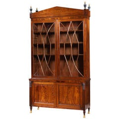 Federal Carved Mahogany Bookcase with Brass Paw Feet, circa 1805-1810