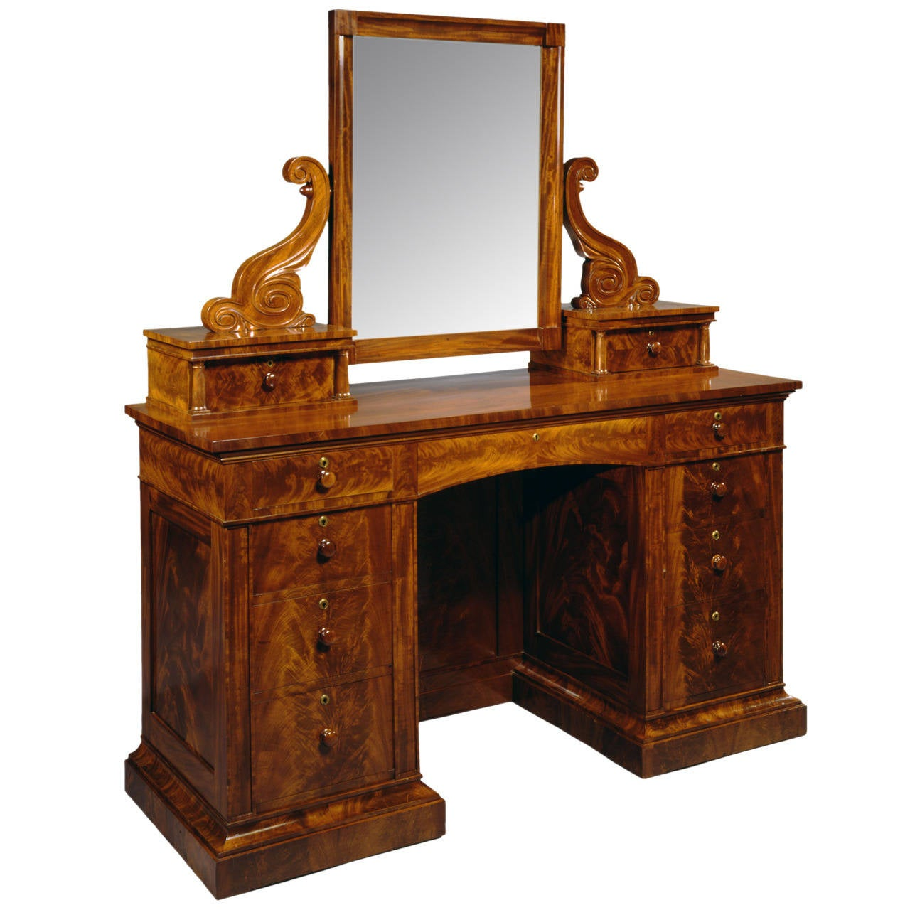carved mahogany dressing bureau with attached mirror