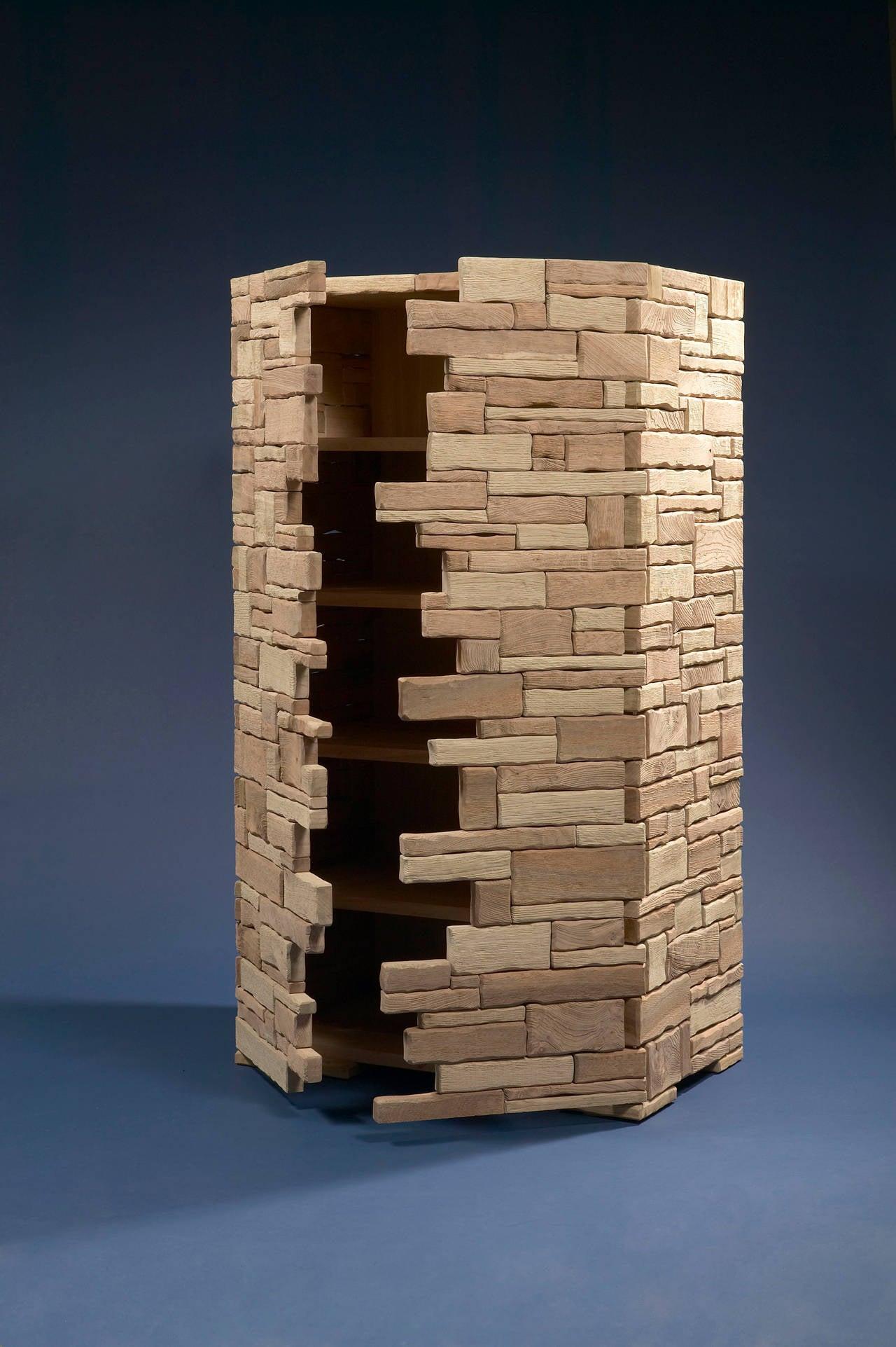 Mur. Cat-Berro Edition, 2006 Large storage unit. Carved oak and elm tree wood. Two doors, four shelves.  Measures: H 70.5