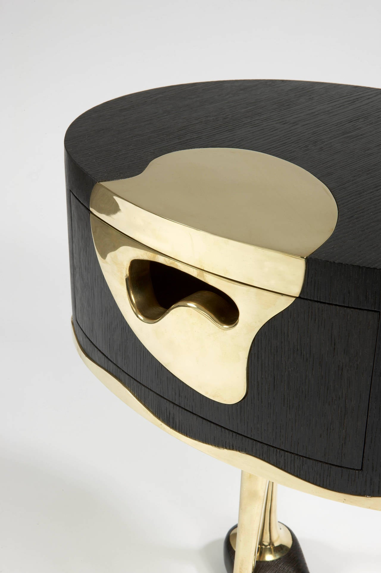 UFO. Cat-Berro Edition 2008.  Stained oak and bronze.  One-drawer. Side table.  Measure: H 65 cm. O 50 cm. H 25 ½ O 20