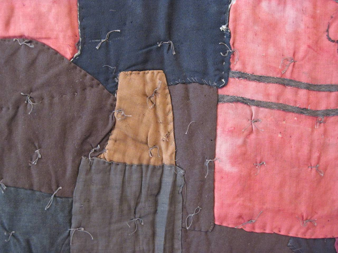 An exceptional African-American quilt made in rural Mcintosh County, Georgia, no later than 1900 and most likely somewhat earlier. This incredible piece of handiwork has much in common with the well-known quilts of Gee's Bend, but is a much earlier,