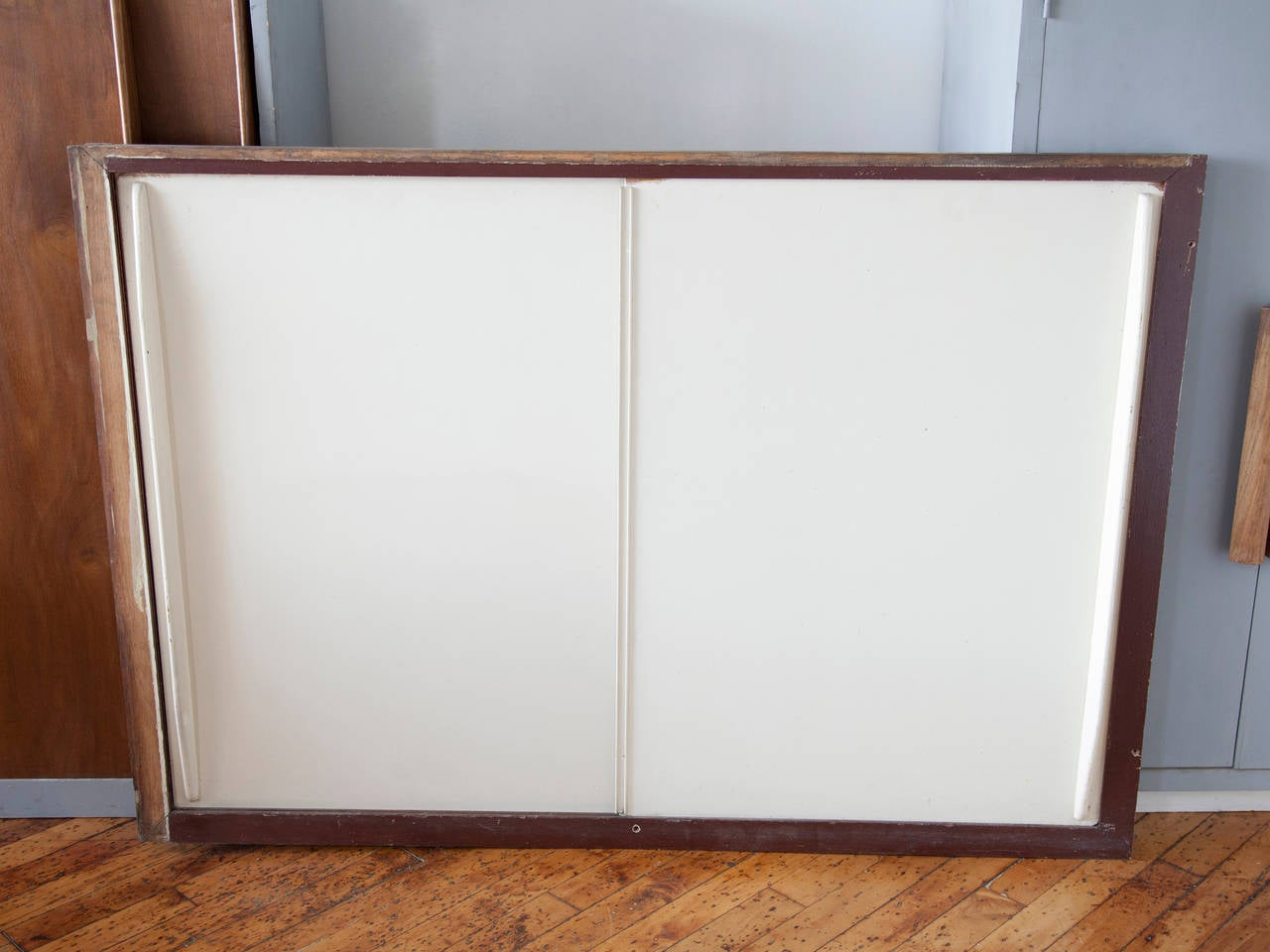 20th Century Jean Prouvé Sliding Cabinet Doors in Frames For Sale