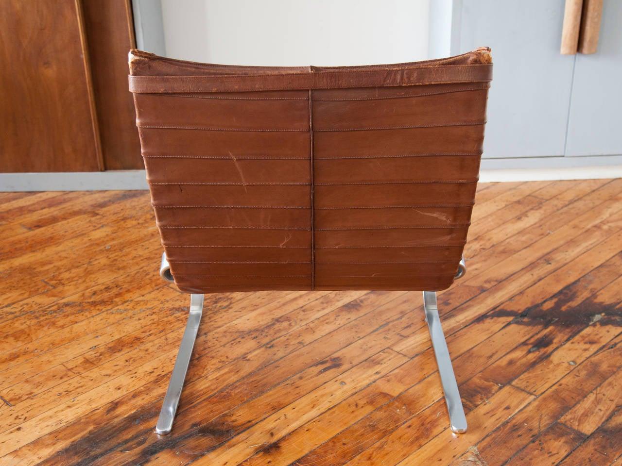 Leather and chrome-plated steel PK-20 chair by Poul Kjærholm, manufactured by E. Kold Christensen, Denmark. Unlike many of his Scandinavian contemporaries whose main focus was wood, Kjærholm was primarily interested in exploring steel for its