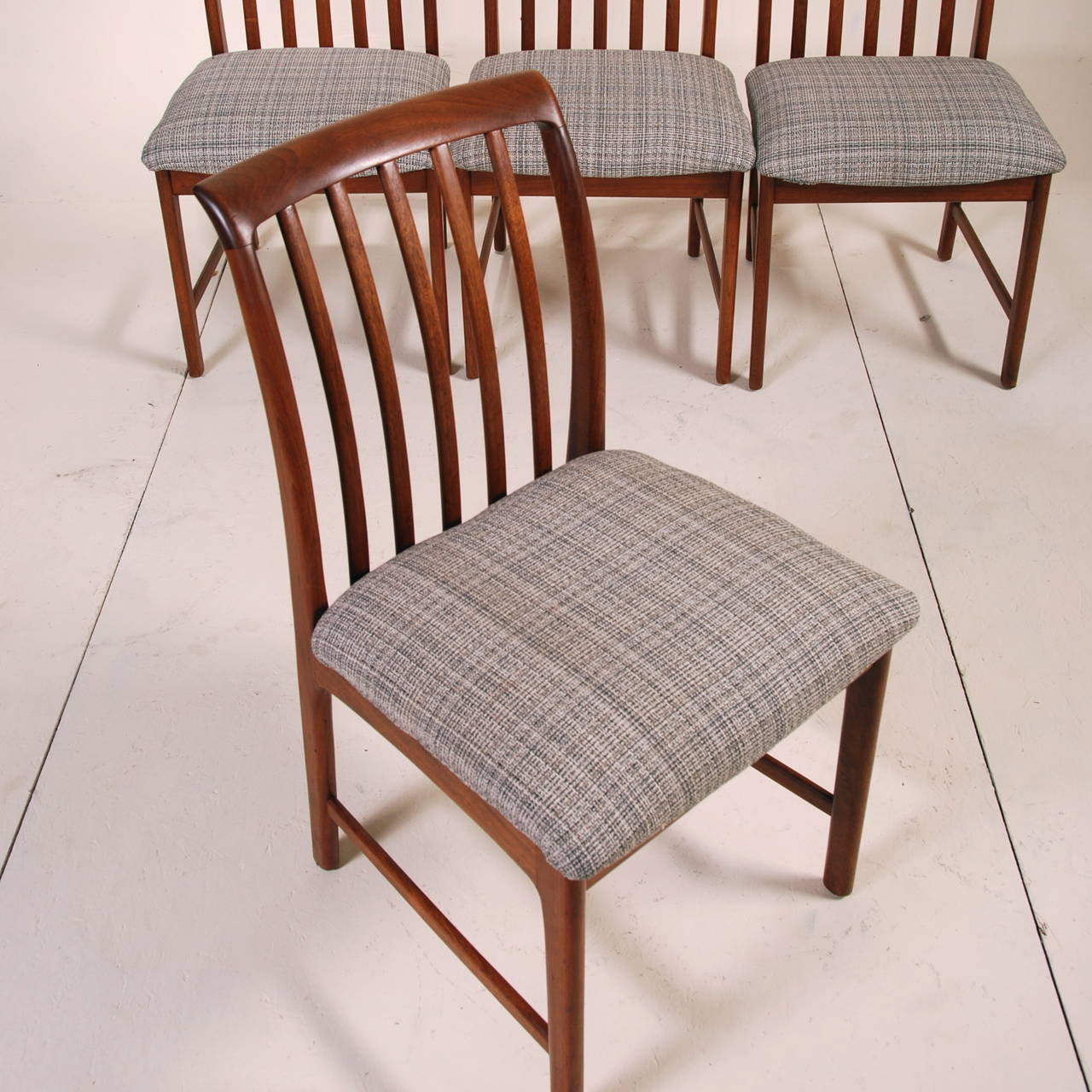Set of four modern walnut dining chairs by folke ohlsson for Walnut dining chairs modern