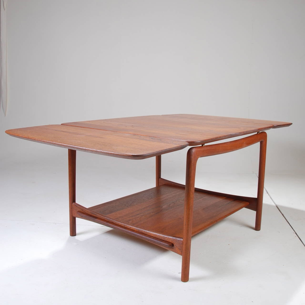 Solid teak drop leaf coffee table by peter hvidt for john stuart at 1stdibs Solid teak coffee table