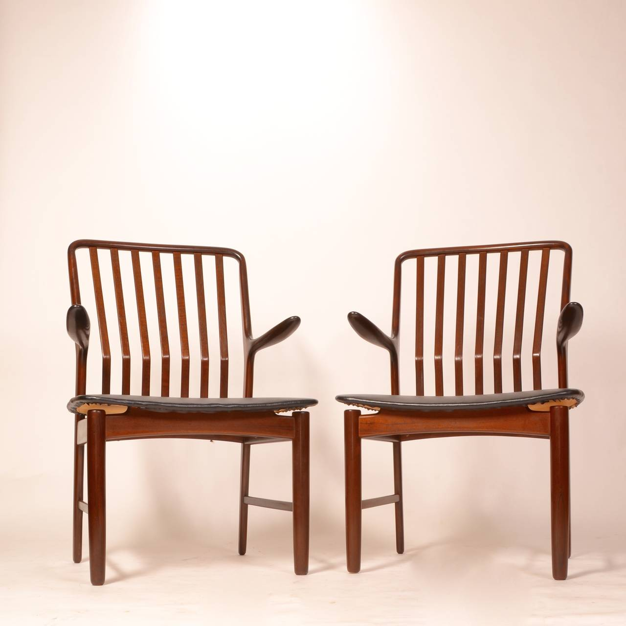 Beautiful set of 2 Danish modern dining chairs designed by Svend A. Madsen, imported by Moreddi, circa 1960s.  Armchairs with wonderfully shaped armrests & curved backs for extra comfort and large seats. A very sturdy design.