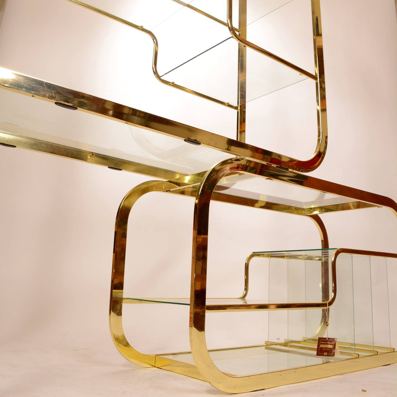 mid century modern brass and glass etagere by milo. Black Bedroom Furniture Sets. Home Design Ideas