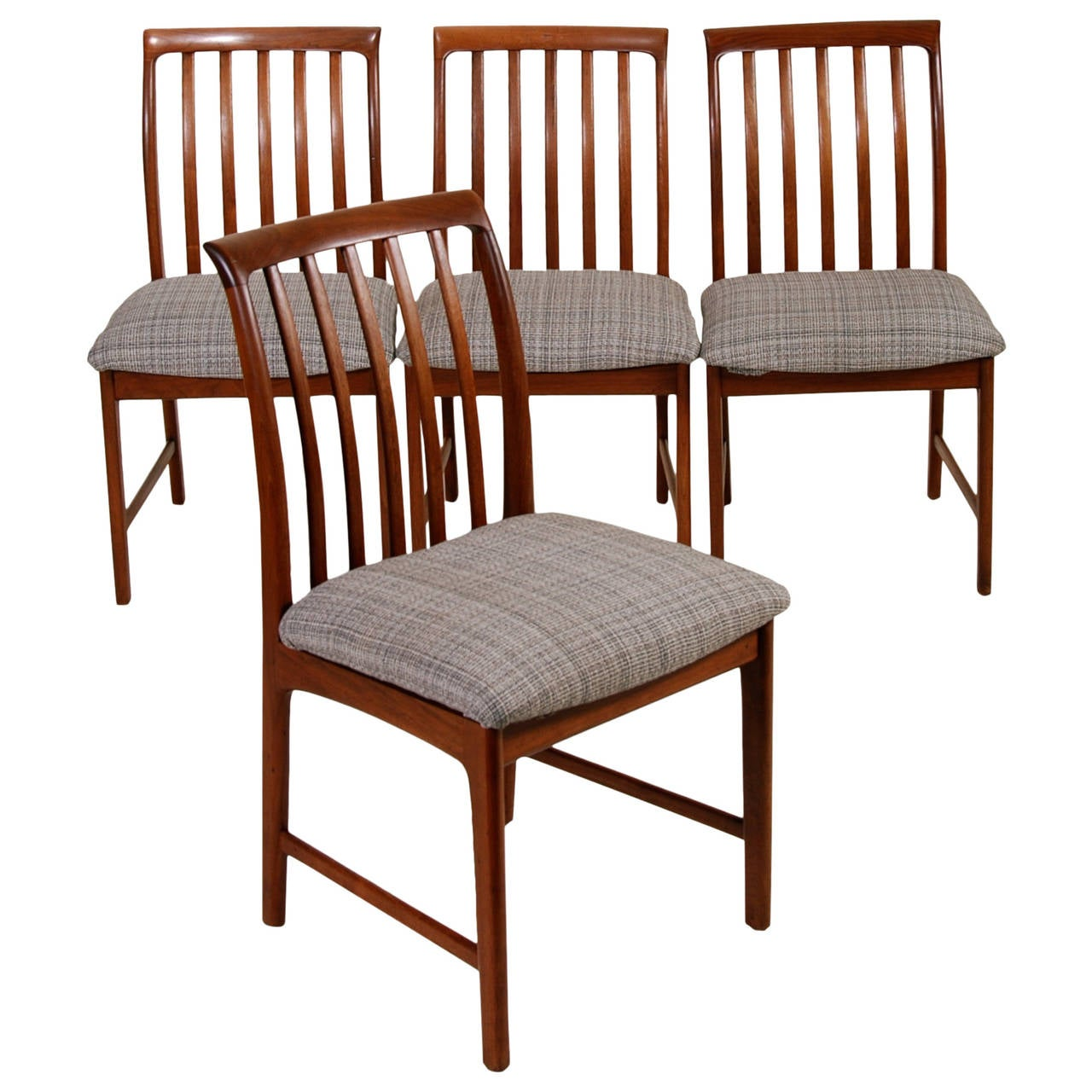 Set of four modern walnut dining chairs by folke ohlsson for Contemporary walnut dining chairs