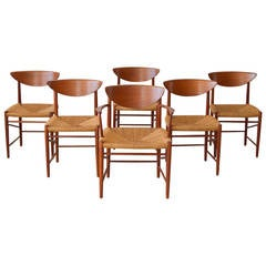 Peter Hvidt/Orla Mølgaard-Nielsen Sculpted Teak Dining Chairs