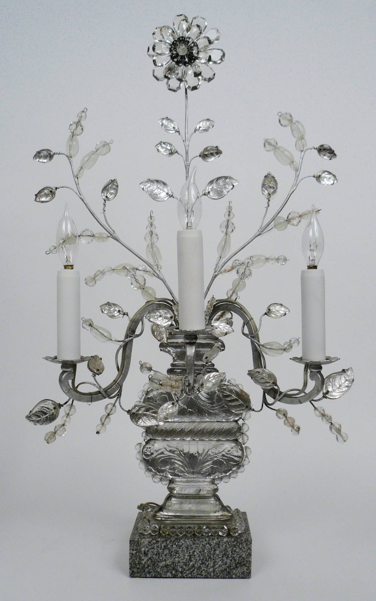 This pair ofBaguès three-light candelabra dating from the first quarter of the 20th century were retailed by E.F. Caldwell, New York.