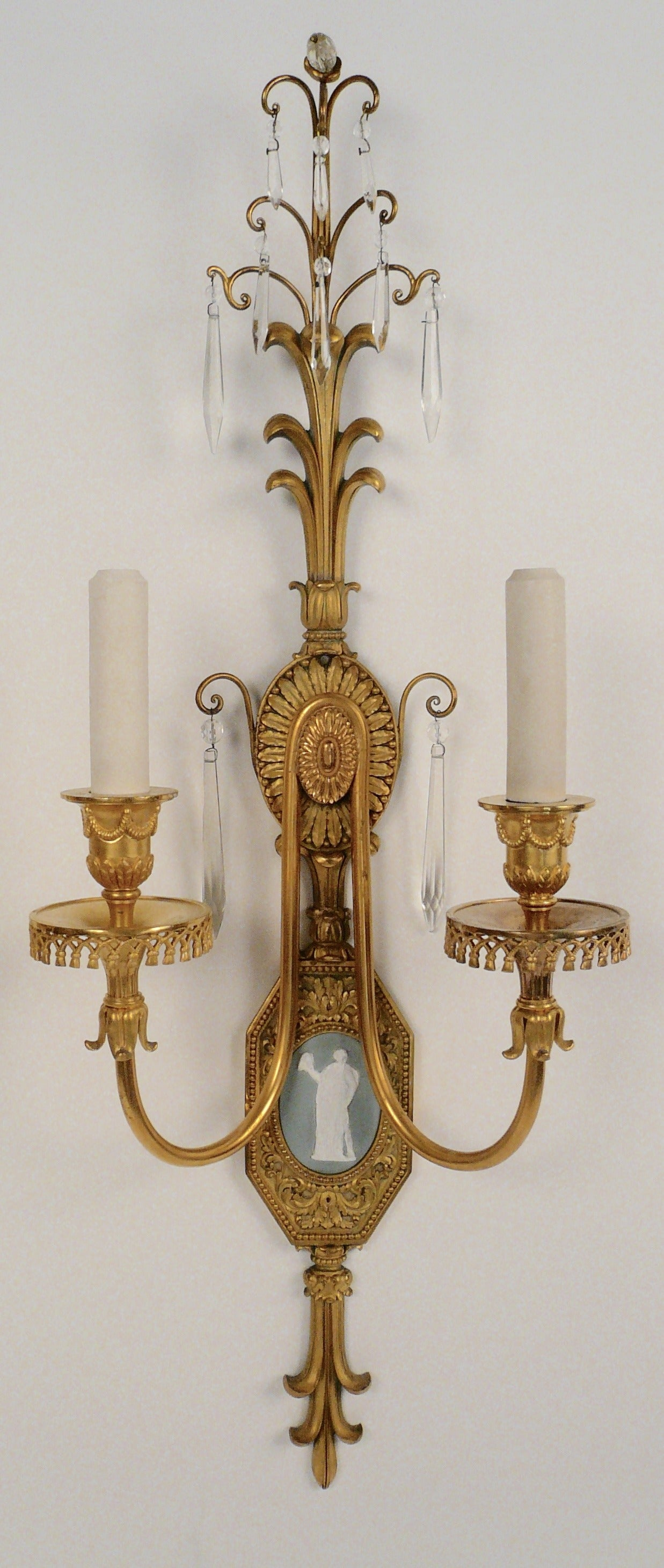 Pair of fine detail and proportion, these hand chased gilt bronze sconces are mounted with enamel on copper Wedgwood jasperware style plaques.