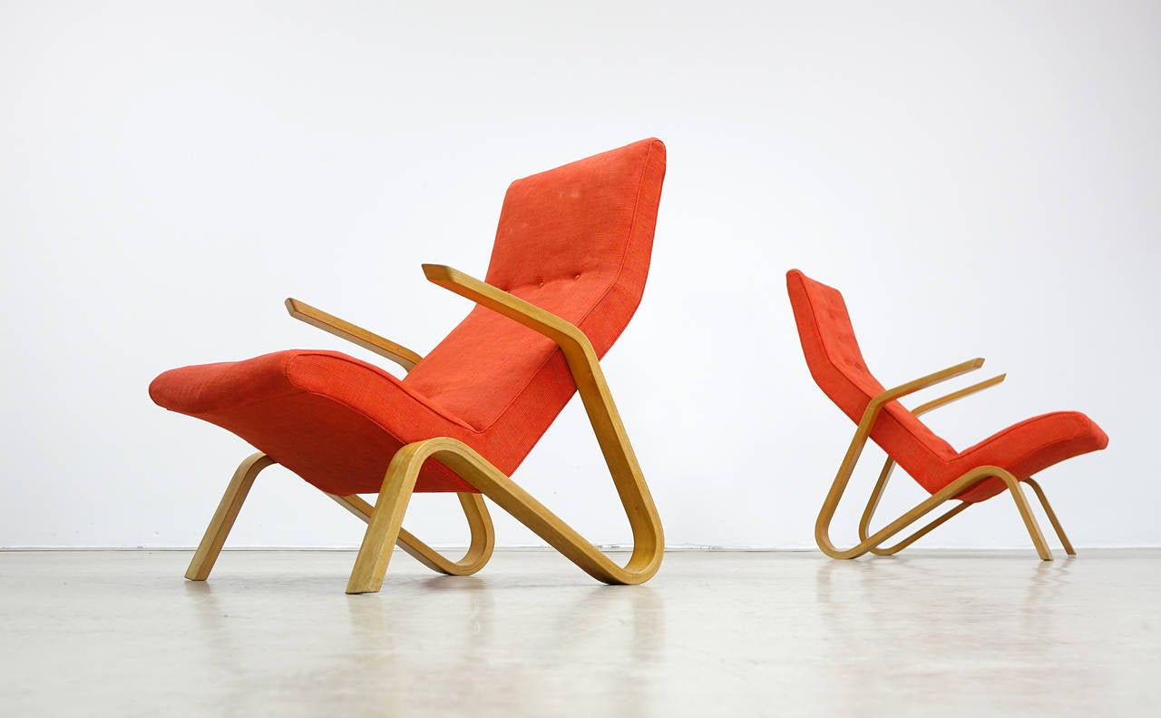 Eero Saarinen for Knoll International, 1946.  Legendary grasshopper easy chair (one of two). Plywood parts are in very good condition, early Knoll International label. The orange-red fabric is of origin and in nearby perfect cond. the